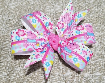 3 inches peppa pig inspired pin wheel hair bow on a non slip alligator clip