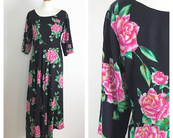 Beautiful, black floral vintage dress with dipped hem. Size 10-12