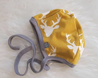 Mustard elk pilot hat by Little Lapsi. Baby hat with ties.