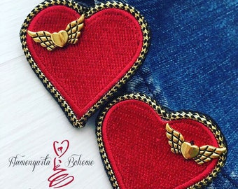 Angel's heart earrings.