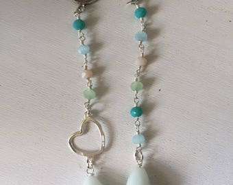 Rosary earrings with heart and drops.