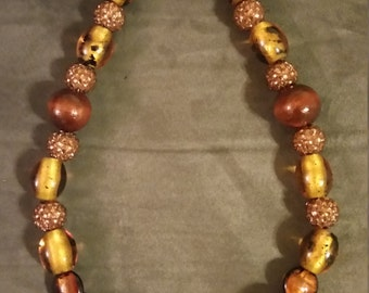 Shades of Brown necklace with acrylic and crystal beads with a toggle clasp.