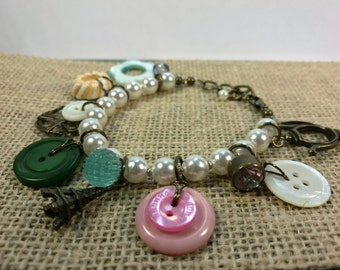 "Vintage pearl and button ""Paris"" charm bracelet"