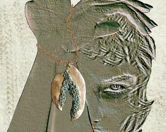 Golden bronze pendant, green patina