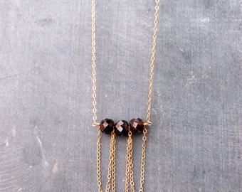 frills... gold garnet necklace / large garnet rondelle & 14k gold filled bib necklace / january birthstone