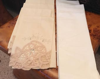 Lovely set of table linen napkins each set has four ivory and white