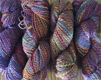 930 yards of hand dyed, hand spun merino sport-weight yarn