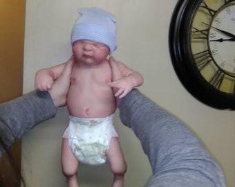 Full bodied reborn baby boy, very life-like