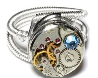 Steampunk ring, Steampunk Jewelry, Antique Watch Movement with Light Blue Crystal - Silver tone
