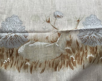 Pretty hand sewn linen table cloth in the design of deers grazing in the moors with cloud-like trees around the edge 1960's