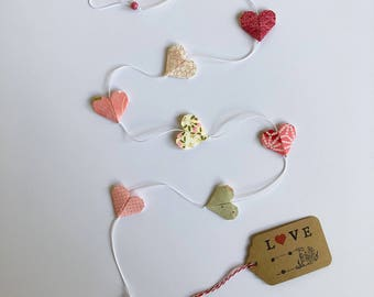 Garland with 7 pink and white origami paper hearts Bell