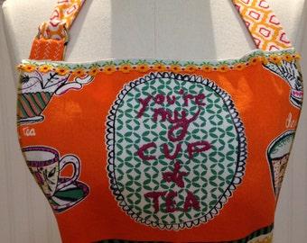 Womens full apron orange yellow tea cups long fabric ties vintage trim repurposed linens Daisy trim bodice towel loop ruffled hem 2 pockets