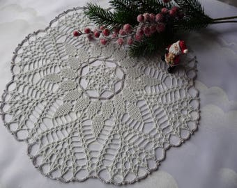 Light grey and silver doily hand crochet.