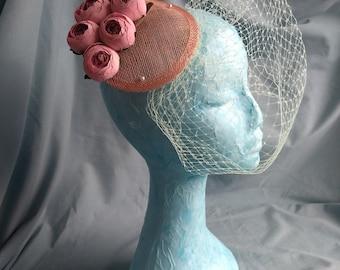 Pink rosebud fascinator with mint green veil
