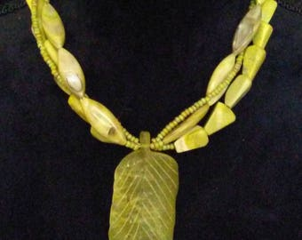 Hand carved agate leaf focal, three strands of mother of pearl, yellow-green turquoise and picasso seed beads.