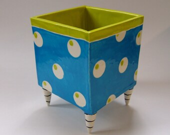whimsical pottery Planter, bright blue with gum ball polka-dots, Black & White striped Beetlejuice legs