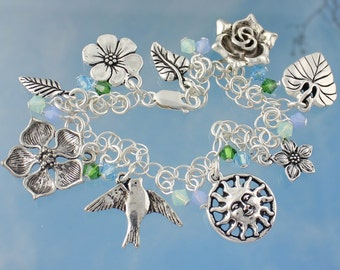 Spring Day Charm Bracelet - Flowers, birds, leaves & sun charms, aqua and green crystals - sterling silver chain - free shipping USA