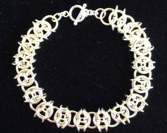 Pretty Celtic Weave Bracelet. Silver Filled Rings and Sterling Silver Clasp