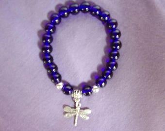 Royal blue stretch bracelet with dragonfly charm