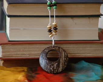 Huge coconut hoop on knotted cord necklace, get ready to hula
