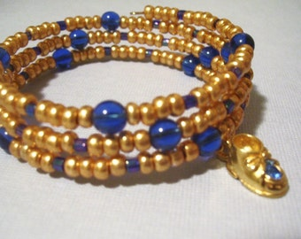 Gold and Blue Wrap Bracelet With Gold Baby Shoe Charm