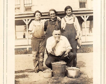 Three berry picking girls in overalls with their father            undated sepia photo