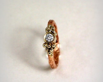 Rustical gold engagement ring with diamond