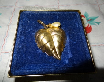Avon Brooch with cologne.