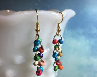 Multi-color tiny dangling beads earrings on brass wires.