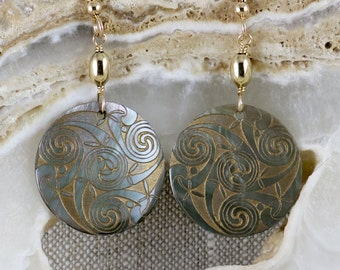 Gray and gold laser-engraved shell pendant makes this neutral earring a knockout