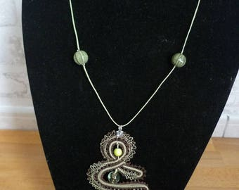 Lace pendant with spindles, glass bead, ceramic bead