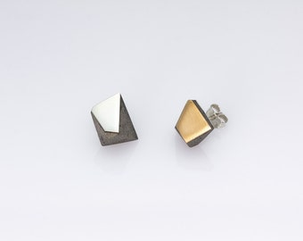 Concrete, sterling silver and bronze earrings.