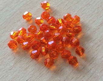 Orange faceted bicone beads bag