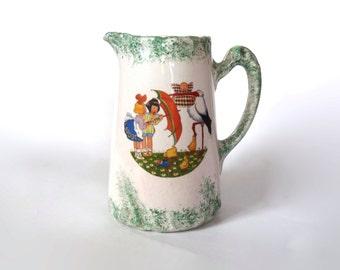 Antique stoneware pitcher. Children, stork, & duck decor. Sarreguemines. French Art-Nouveau jug.
