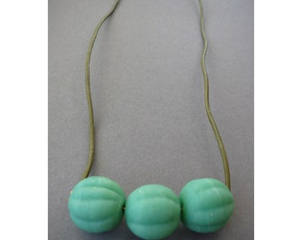 Handmade necklace- heavy matte turquoise glass spheres on olive cord