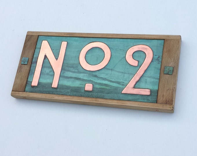 """Street number sign in Mission Mackintosh style  3""""/75mm, 4""""/100mm in copper with oak frame, prefix No followed by 1 x number g"""
