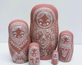 Pink nesting dolls, matryoshka dolls in dolls, russian dolls
