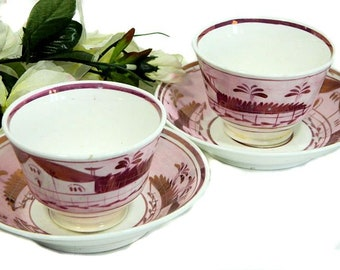 A Pair of Early 19th Century Antique Hand Painted Staffordshire Pink Luster Handleless Cups and Saucers Houses