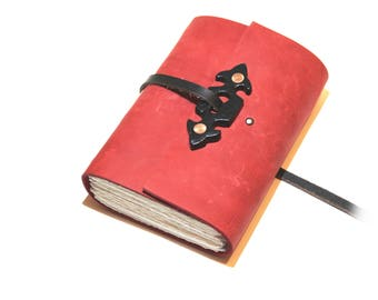 The Red Journal - Handmade leather journal with escutcheon decoration