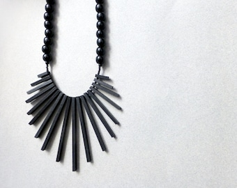 geometric tribal statement necklace with black sticks and beads , contemporary jewelry