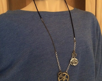 Steampunk necklace: gears and watch parts I
