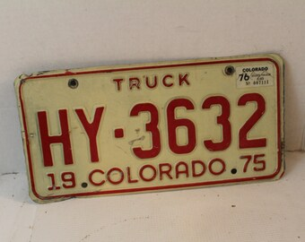 vintage 1975 Colorado Truck license plate HY-3632 red white