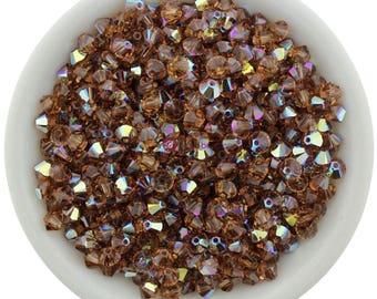 Light Smoked Topaz AB (4mm) Swarovski Crystal 5328 Xilion Bicones