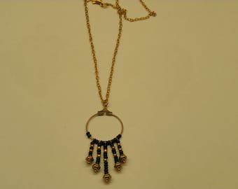 Necklace in gold tone and black glass beads