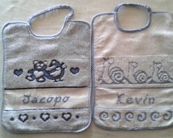 Bib embroidered in cross stitch