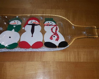 Hand painted snowmen on flattened wine bottle spoon rest