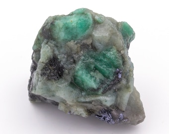 Raw emerald stone of 46 grams with matrix of black mica and quartz.