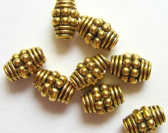 30 Oval beads antique gold metal spacer beads jewelry supply 7mm x 5mm lead free nickle free 80144-AG(X4)