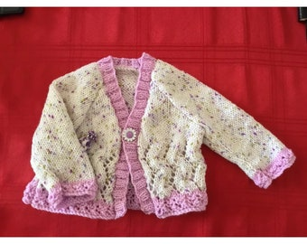 "New hand knitted baby girls Lacy cardigan in a Lilac and green  Smarty yarn (Mishmosh) 6-9 Months 21"" chest with Flower button."