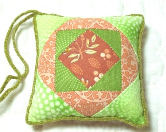 Small Patchwork PINCUSHION made from green and orange Cotton Fabrics